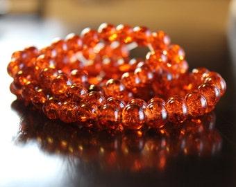 100 approx deep orange 8mm crackle glass beads, 1mm hole