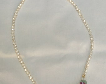 Fresh water pearl and ruby in ore necklace. 24