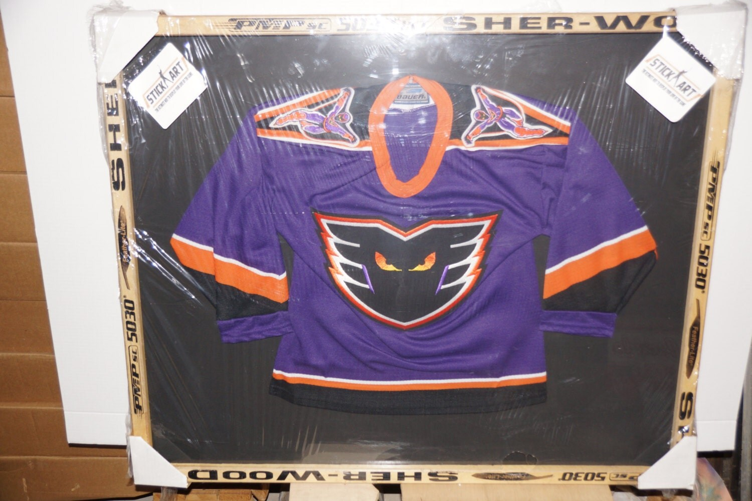 real phantoms hockey jersey framed in real hockey sticks