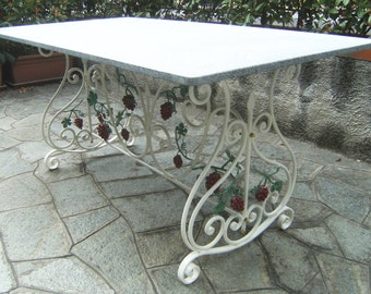 Wrought iron table rectangle scrolls and grape bunches of decorum.