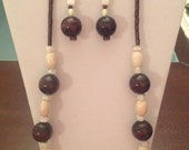 3 piece jewelry set.  Necklace, Dangle earrings and bangle with stone and wood beads. Fits most wrists.