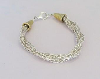 Bracelet made of fine silver twisted Viking knit.