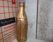 Brass Coca-Cola bottle