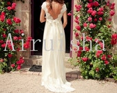 Gorgeous lace bodice sexy backless with beautiful skirt and sash wedding dress