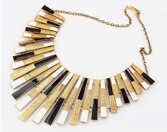 bold statement necklace, modern metal necklace, golden, black and white, Cleopatra inspired, ancient Egypt look