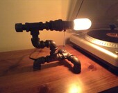 Black iron industrial pipe table lamp