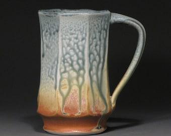 Faceted mug, porcelain with blue ash and matt rust glazes