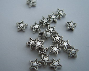 Silver star beads - tiny star spacer beads antique silver 4mm pack of 50 SBS007