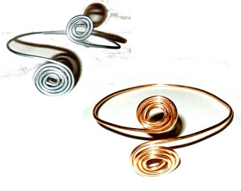 Pick color:  swirly upper arm bracelet