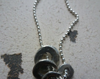 sterling silver.free form.discs.