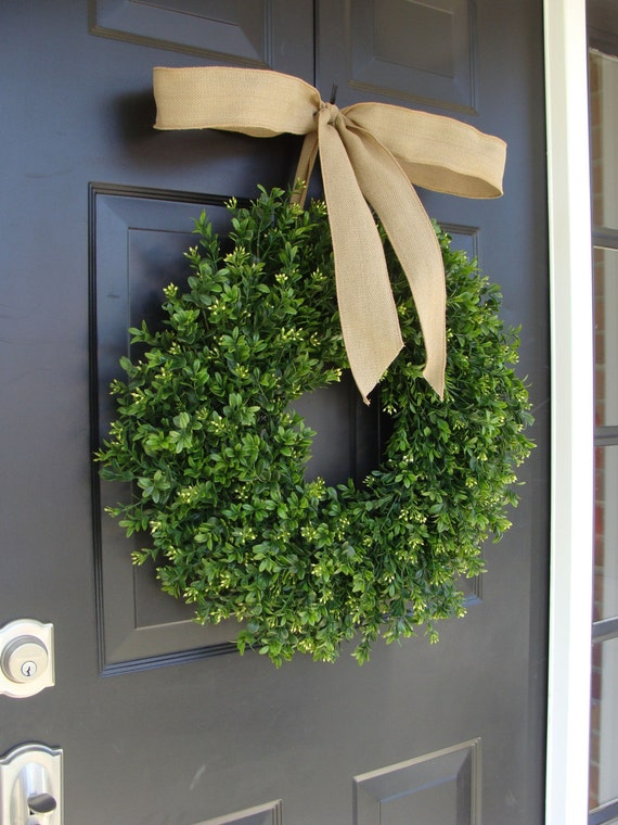 Custom Thin 22 inch Boxwood Wreath with pin stripe custom bow attached around the top of the boxwood wreath