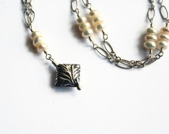 SALE White Pearl and Silver Necklace with Leaf Textured Bead Dangle