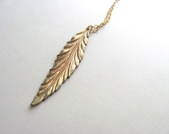 Golden feather necklace on long 14k gold plate chain