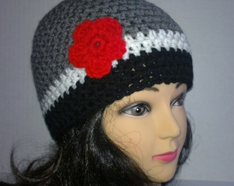 Black, White and Gray Crochet Hat With Red Crochet Flower