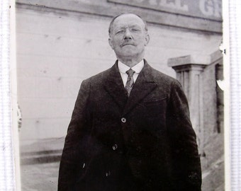 French Photograph - Man in Front of a Hotel