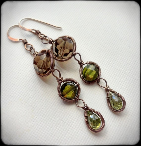 Sale. Reduced to 24. Green peridot colored Swarovski crystal earrings with silver