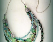 SOLD-Celtic Warrior Princess' multi-tier with silver chain, green everywhere, triskele patterned beaded necklace: Celtic Spring