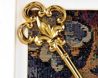 Framed Key on Tapestry in White Frame