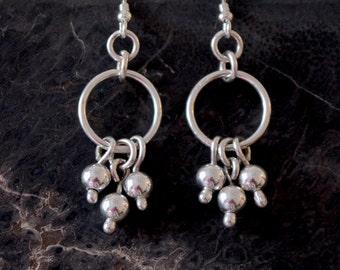 Sterling silver Cha Cha earrings.  hand made.  'Cha Cha Ching'