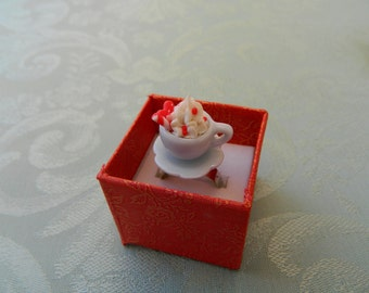 A very sweet ring, with strawberry & cream