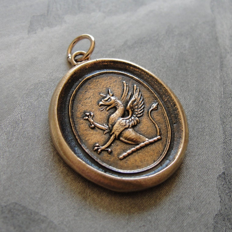 griffin wax seal pendant in bronze strength courage boldness