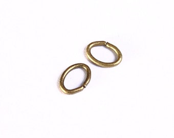 5mm Petite antique brass jumpring - oval jumpring - open jumpring (993) - Flat rate shipping