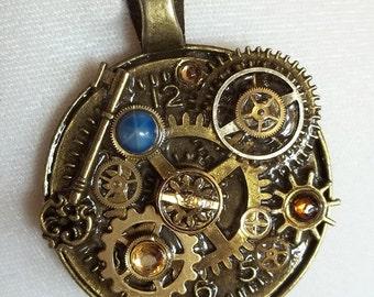 Steampunk Pendant -  Clockwork Key to the Comos