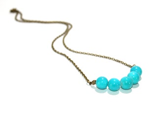 Simple beaded necklace in turquoise with antique brass chain and findings