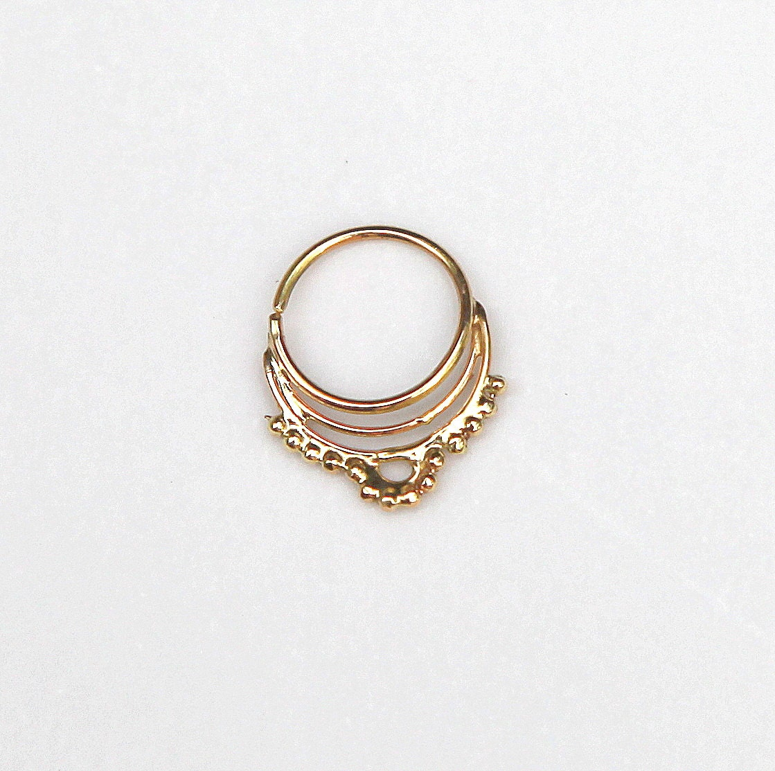 Septum jewelry All septum jewelry Basic septum jewelry Clicker Captive Seamless Gold Pinchers Circular barbells Tusks & spikes Retainer Plugs Ornate & hanging jewelry All 14k Gold Eka Septum Clicker LIMITED $ Approx Gauge(s): 16g More colors available. 14k Gold Lila Septum Clicker LIMITED $