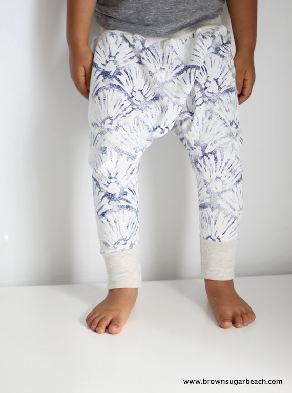 Kids harem pants are mini versions of the pants that performers such as MC Hammer wore in his music videos and on stage at concerts. The style features a dropped crotch that reaches a few inches of above the knee and then tapers completely to wrap snuggly around the leg, calf, and ankle.
