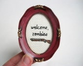 Welcome Zombies -- Zombie cross stitch welcome sign with shotgun