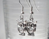 Cute double sided owl earrings in silver and antiqued gold