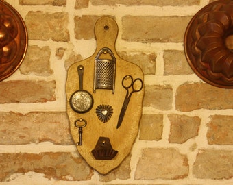 Vintage wall hanging, cutting board with vintage kitchen tools