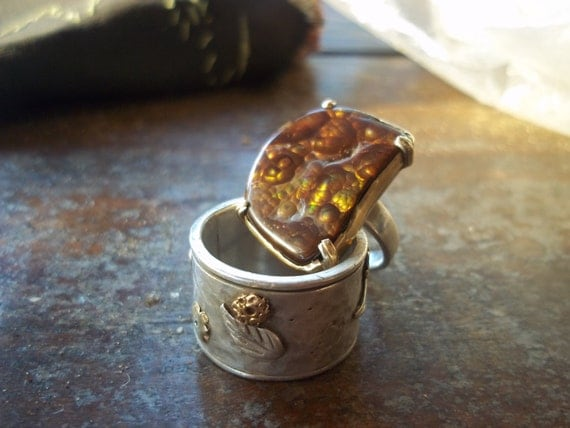 spacey fire agate set is silver with a 22 ct gold line around the gem, Mexican fire agate