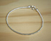 High Fashion Sterling Silver Beaded Bracelet Strung on Silver Wire with Delicate Silver Beads - Great for Layering Stacking Jewelry