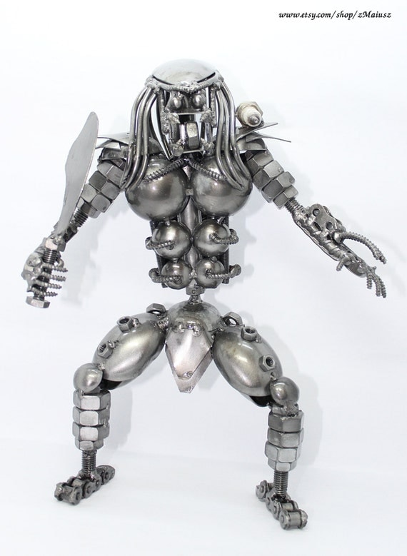 "Handmade scrap metal predator (11.5"" tall) with shoulder canon and knife"