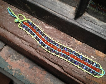Bracelet: dyed orange jade and dark violet blue glass