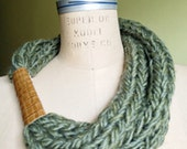Hand knitted green/grey wool necklace with brown leather cuff