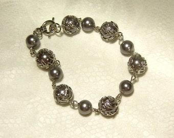 "Cynthia Lynn ""FINISHING TOUCH"" Silvertone Grey Glass Pearl Toggle Bracelet - 8 inches"