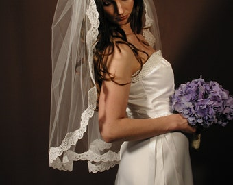 "Manitlla veil veil - Past elbow length 34"" with Alencon lace."