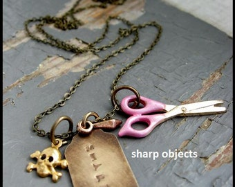 Salon -  layered spikes, miniature pink scissors, small metalwork skull & stamped tag charm, chain necklace
