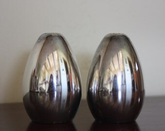 Salt and pepper shakers, hand crafted by International Silver Company