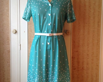 Aqua 1970s Osti classic dress with white floral pattern and belt