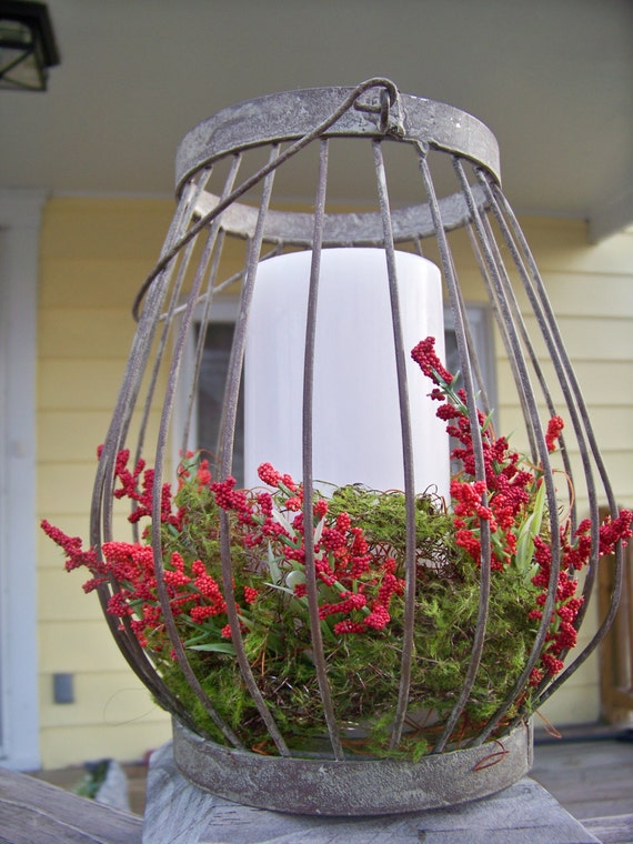 Moss and berry lantern centerpiece by