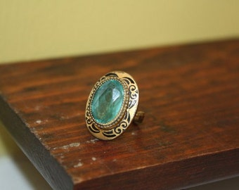 1950's Art Deco Ring.  Antique Gold Metal.  Green Stone.