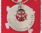 You Make Me Smile Hand Stamped Silver Aluminum Keychain with a Red Lady Bug Charm