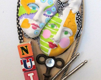 PUBLISHED  I'm A Schizophrenic & So Am I Recycled found object sculpture