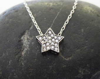 Black silver and pave crystal star necklace