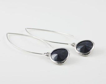 Dark Lapis Lazuli Earrings Surrounded By A Shiny Silver Tone Frame