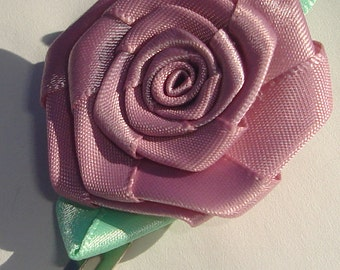 mauve fabric rose with green leaves hair clip
